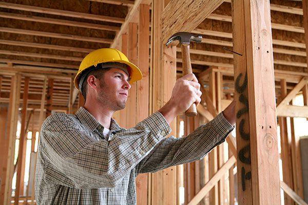 Construction Man Using Hammer